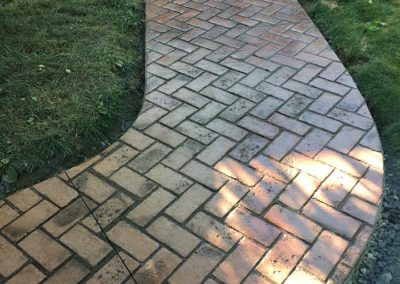 Front walkway with a beautiful herringbone brick impression with fieldstone patio1