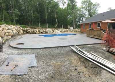 Massive 1400 sq ft pool deck textured to simulate a slab of granite 2