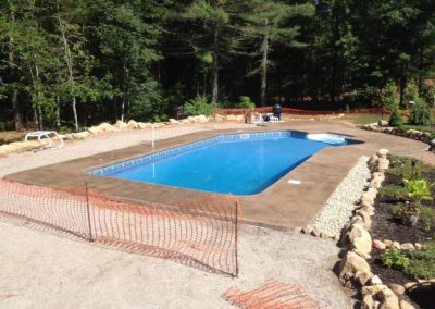 Pool apron in Carolina, RI. Rock salt finish with cantilever coping.